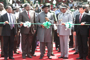 President Jonathan being assisted by Dikko Abdullahi customs CGS cutting the tape to commission the customs command and staff college Gwagwala Abuja.	Photo: State House