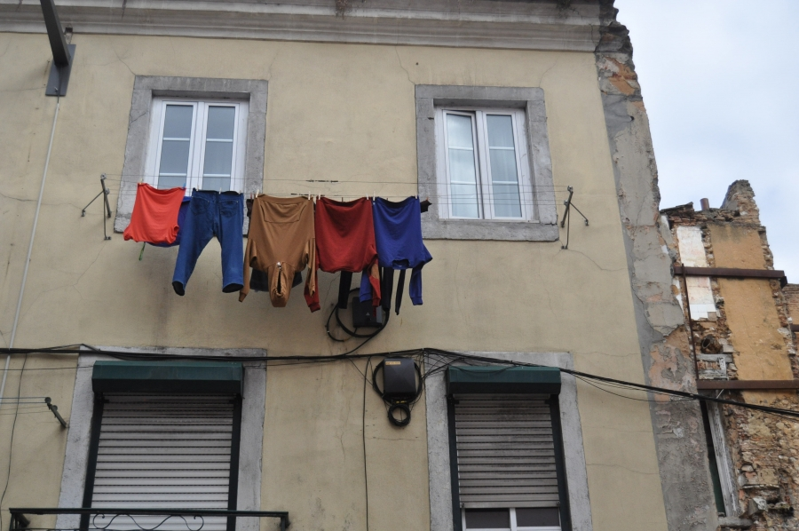 wash hanging from a window in lisbon