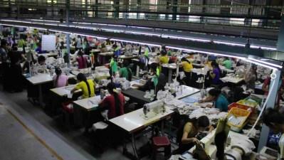 Rows of garment workers work on a factory floor in Myanmar