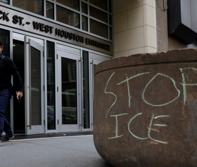 An Officer Stands Outside The Ice Offices In New York City