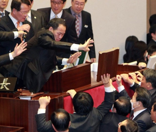 South Koreas Opposition Party Lawmakers Protest At The Chairmans Seat Inside The National Assembly In Seoul To Try To Stop The Ruling Grand National