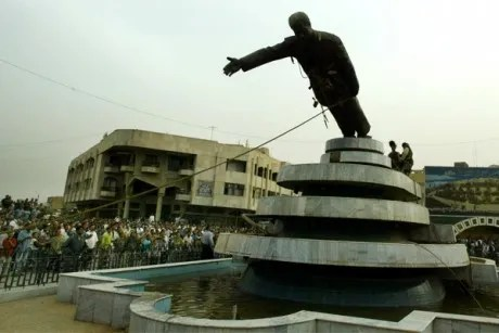 Iraqi citizens pull down a statue of Iraqi President Saddam Hussein in April, 2003.