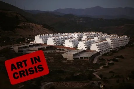An unfinished residential building (L) is seen on a mountain in Estepona, near Malaga, southern Spain January 31, 2012.
