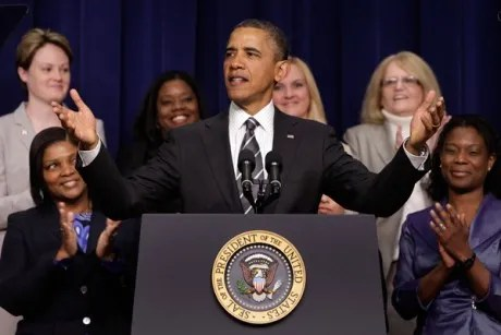 President Obama greets the audience at the White House Forum on Women and the Economy on Friday.