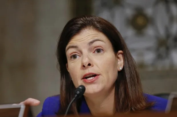 New ad targets Ayotte for vote against background checks