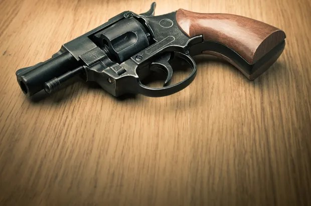 People Shooting Guns Targets