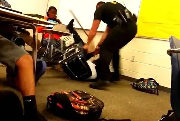 Image result for police sits on black girl