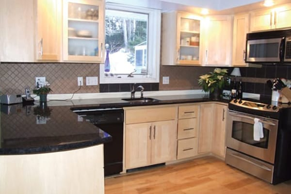 kitchen refacing commercial kitchens don t replace reface instead saltscapes magazine stacey wanted a clean modern look so chose light maple shaker style doors and drawerfronts installed frosted glass in few