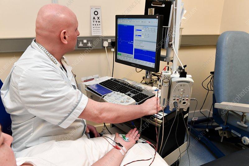 Nerve conduction test on wrist patient - Stock Image ...