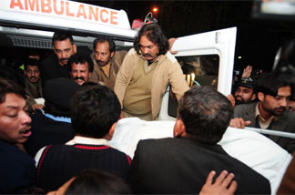 The body of Punjab Gov. Salman Taseer is loaded into an ambulance in Islamabad earlier today. Photo: Farooq Naeem/AFP/Getty Images