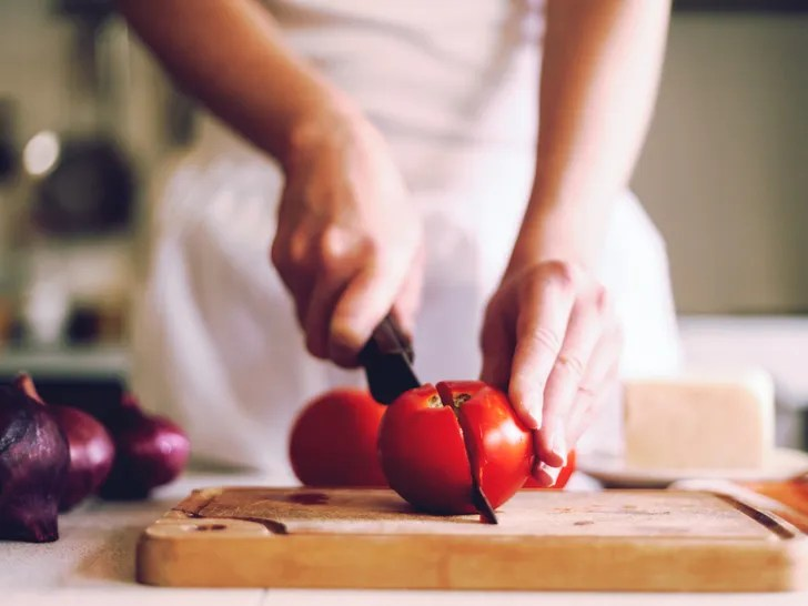 affordable kitchen knives tables ashley furniture the best chef s and how to keep them sharp self woman cutting tomato