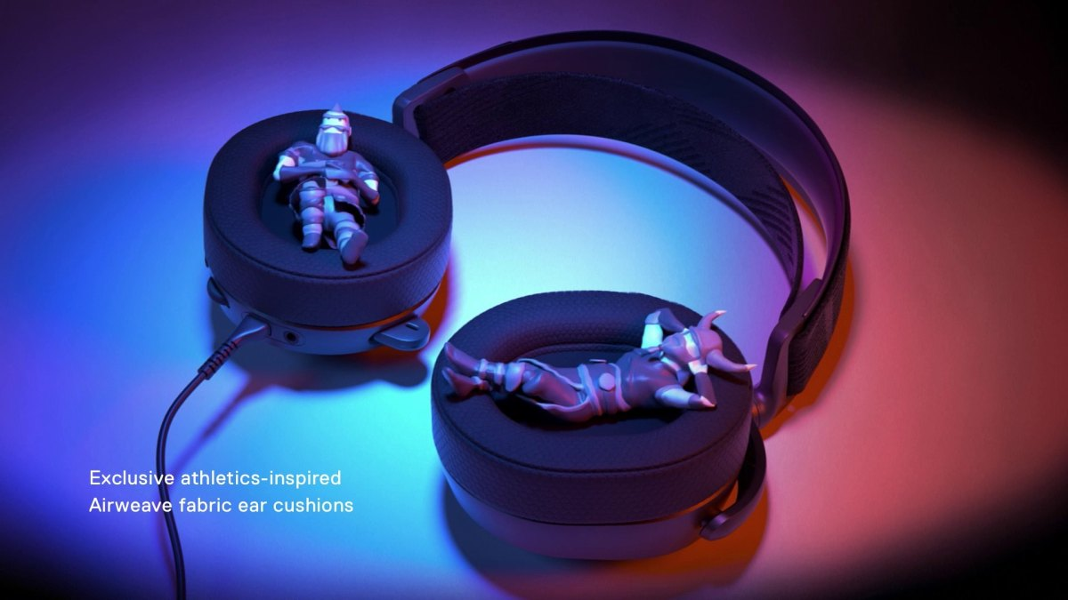 Arctis earcups with small figurines laying comfortably inside them