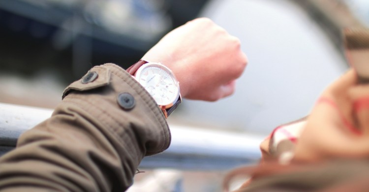woman looking at watch, how satan uses scripture against you