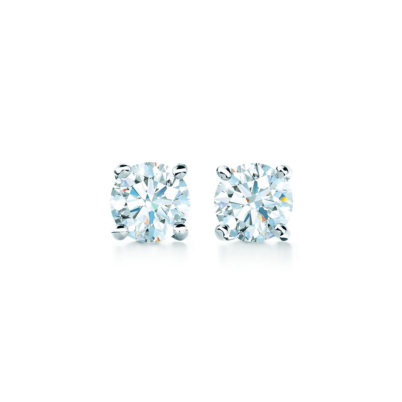 Tiffany solitaire diamond earrings in platinum.
