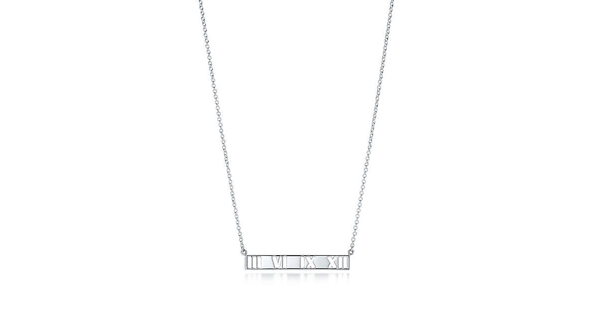 Atlas pierced bar pendant in sterling silver.