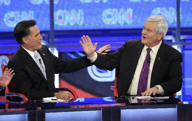 Republican presidential candidates, former Massachusetts Gov. Mitt Romney, left, and former House Speaker Newt Gingrich argue a point during a Republican presidential debate Wednesday, Feb. 22, 2012, in Mesa, Ariz. Gingrich will be in Dalton, Ga., Tuesday.