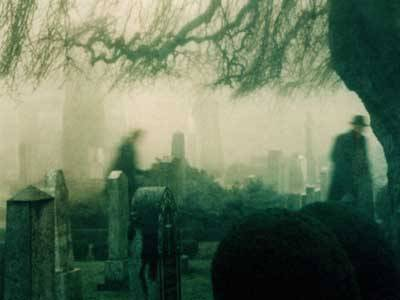 Ghosts haunting a graveyard