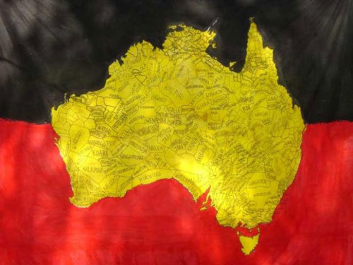 Golden map of Australia showing all the indigenous regions associated with different groups, on a background of black above and red below