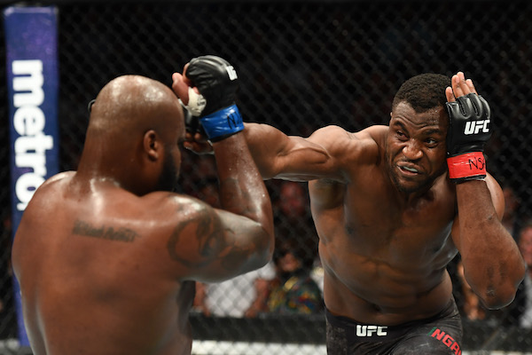 <a href='../fighter/francis-ngannou'>Francis Ngannou</a> punches <a href='../fighter/Derrick-Lewis'>Derrick Lewis</a> in their heavyweight fight during the UFC 226 event inside T-Mobile Arena on July 7, 2018 in Las Vegas, Nevada.