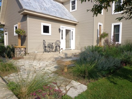 Flagstone walk with planting beds