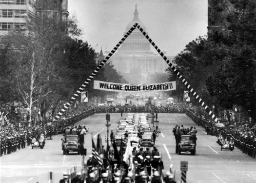 Now *that's* a royal welcome: organizers turned Washington, D.C.'s Pennsylvania Avenue into a be-streamered parade route welcoming Queen Elizabeth II to the States in October of 1957. The motorcade makes inaugural festivities look almost modest. *From Popperfoto/Getty Images.*