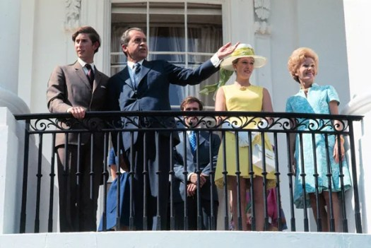 Brits and balcony photographs: ever the happy couple. Foppish, floppy-haired Prince Charles—age 22 at the time—surveys the kingdom that might've been his, had those tea-dumping settlers been squelched. To his left: President Nixon, gesturing to the White House grounds from its South Portico balcony; Princess Anne, in a sunny frock; and Mrs. Nixon, in blue. *© Bettmann/Corbis.*