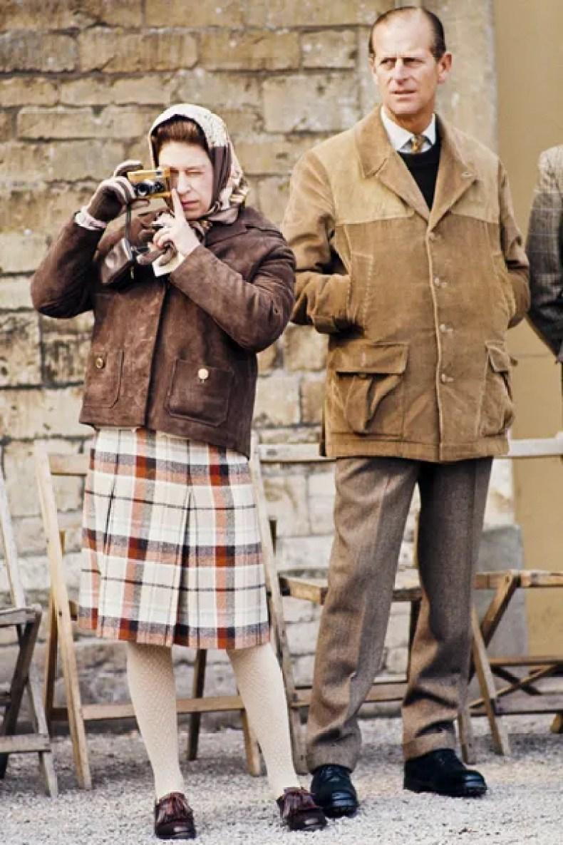 Image may contain Skirt Clothing Apparel Human Person Prince Philip Duke of Edinburgh Coat Footwear and Shoe