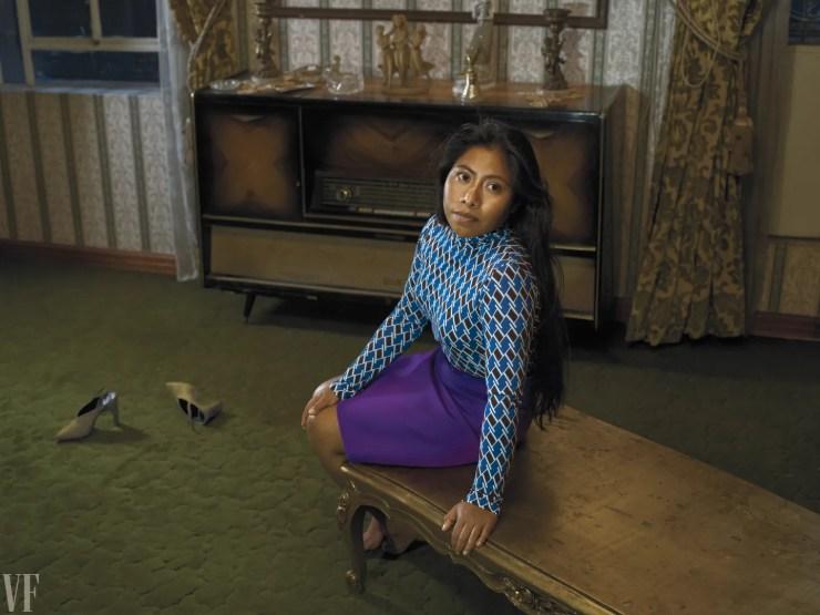 Yalitza Aparicio poses on a bench in Mexico.