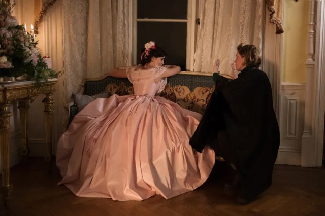 """Emma Watson with Greta Gerwig on set. During a chapter called """"Meg Goes to Vanity Fair,"""" the oldest March sister borrows a fancy dress from her rich friends and gets drunk on champagne at a ball. """"I'm not Meg tonight, I'm 'a doll' who does all sorts of crazy things,"""" she tells Laurie."""