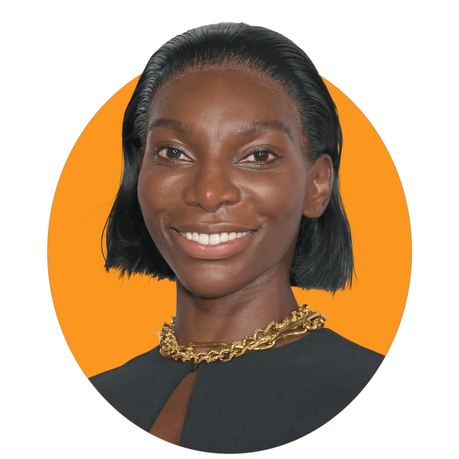 The image may contain face human person Michaela Coel Smile and hair