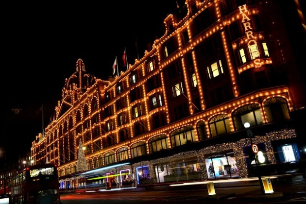 Harrods Building. The historic Victorian architecture of the most famous department store in the world. Facade lit up at night.