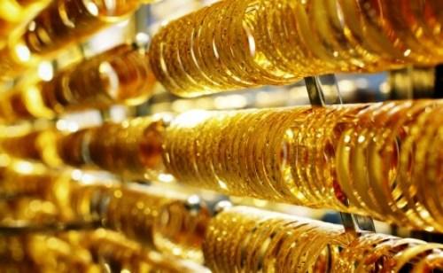 giá vàng thế giới tiếp tục chịu tác động từ vấn đề Hy Lạp và quyết định tăng lãi suất của FED