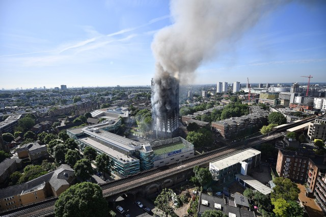 LONDON, ENGLAND - JUNE 14:  Smoke rises from the building after a huge fire engulfed the 24 sage Grenfell Tower in Latimer Road, West London in the early hours of this morning on June 14, 2017 in London, England.  The Mayor of London, Sadiq Khan, has declared the fire a major incident as more than 200 firefighters are still tackling the blaze while at least 50 people are receiving hospital treatment.  (Photo by Leon Neal/Getty Images)