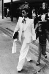 Bianca Jagger wearing sets of Yves Saint Laurent