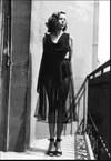Elena Garro wearing a black dress with transparencies