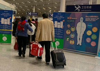 Passengers on Wuhan Flights Shrug at 'Temperature and a Type' Screenings