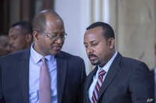 Tagesse Chafo Speaker of House of Representative, left, and Ethiopian Prime Minister Abiy Ahmed, right, leaving the parliament…