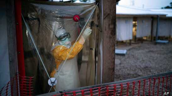 FILE - A health worker wearing a protective suit enters an isolation pod to treat an Ebola patient at a treatment center in Beni, Democratic Republic of the Congo, July 13, 2019.