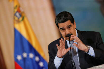 Venezuela's President Nicolas Maduro gestures as he speaks during a news conference in Caracas, Venezuela, September 30, 2019…