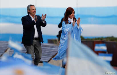 Argentina's presidential candidate Alberto Fernandez and his running mate former President Cristina Fernandez greet supporters during a closing campaign rally in Mar del Plata, Argentina, Oct. 24, 2019.