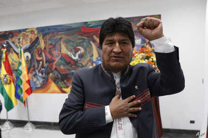 Bolivia's President Evo Morales leaves after a press conference in La Paz, Bolivia, Thursday, Oct. 24, 2019. Morales declared…