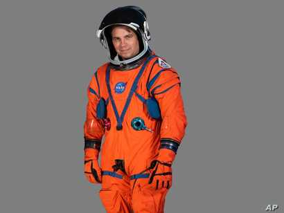 Dustin Gohmert, Orion Crew Survival Systems Project Manager at Johnson Space Center, wearing prototype of  NASA Orion Crew