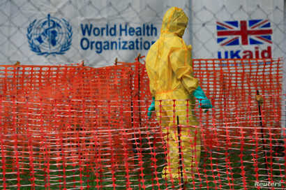 FILE PHOTO: a person dressed in protective Ebola clothing is seen inside an Ebola care facility at the general hospital of Bwera near the border with the Democratic Republic of the Congo in Bwera, Uganda, June 14, 2019. REUTERS / James Akena / File Photo