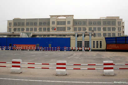 A building of what is officially called a vocational skills education centre is photographed in Hotan in Xinjiang Uighur…