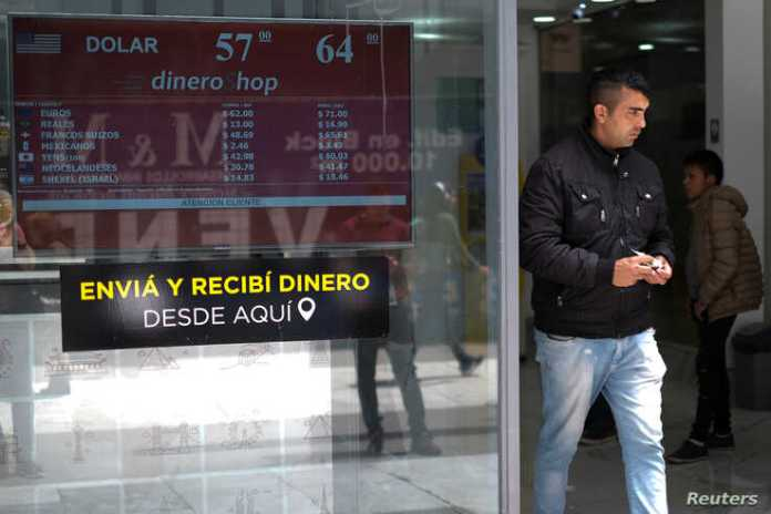 A man walks out from a currency exchange shop in Buenos Aires, Argentina, Oct. 29, 2019.