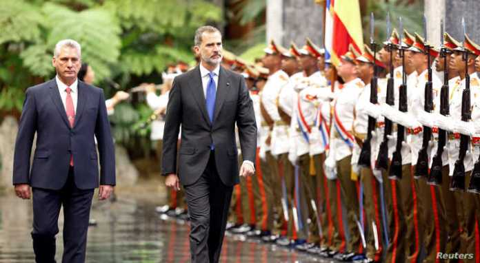 Cuba's President Miguel Diaz-Canel and Spain's King Felipe review an honour guard during a ceremony at the Revolution Palace in