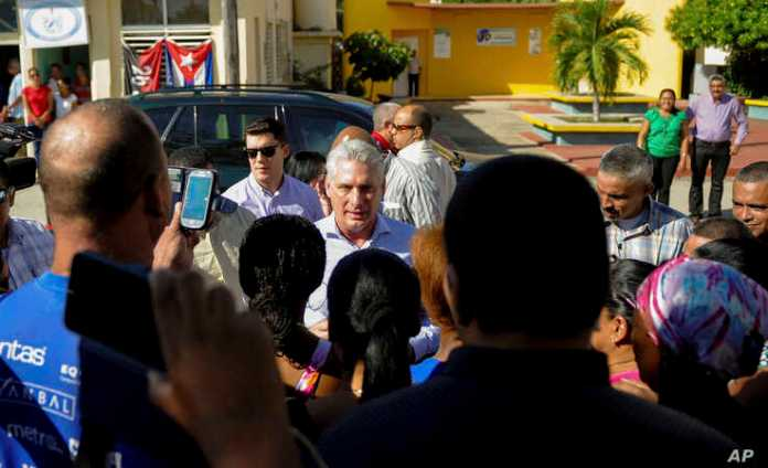 Cuba's President Miguel Diaz-Canel visits with residents after arriving in Caimanera, Cuba, Nov. 14, 2019.
