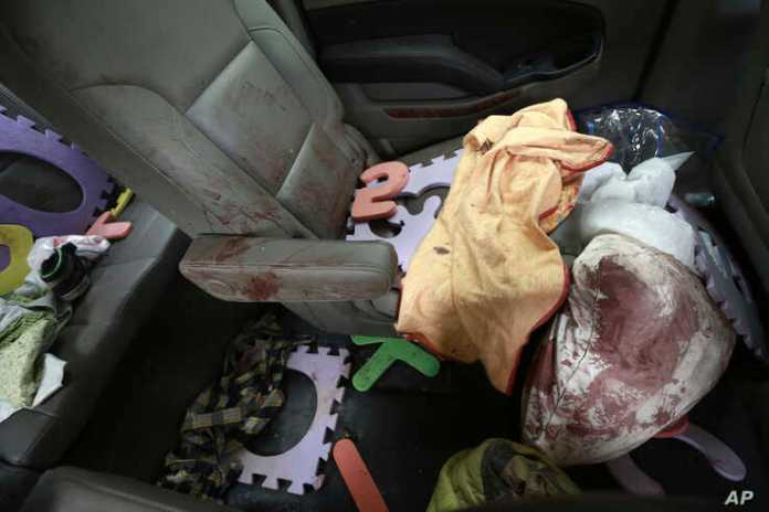 Belongings stained with blood are seen inside a bullet-riddled vehicle that members of LeBaron family were traveling in, on a dirt road in Bavispe, at the Sonora-Chihuahua border, Mexico, Nov 6, 2019.