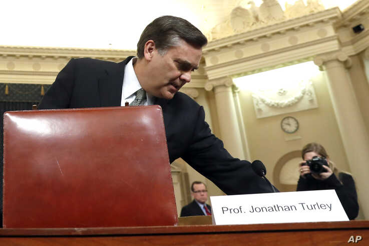 Constitutional law expert George Washington University Law School professor Jonathan Turley arrives to testify during a hearing.