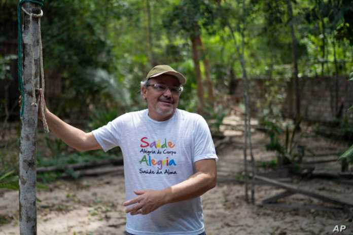 "In this Dec. 1, 2019 photo, Caetano Scannavino, coordinator of NGO ""Saude e Alegria,"" or Health and Happiness, gives an"
